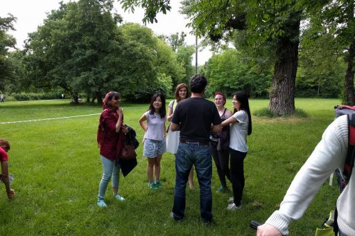 Prof. Gartner with a group of students participating in the orienteering event, giving some hints.