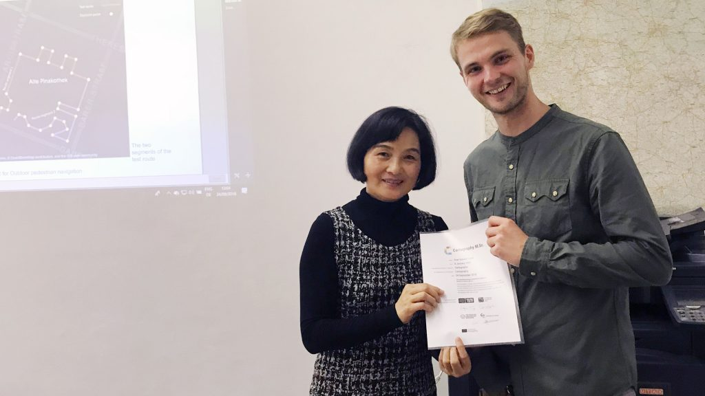 Liqiu Meng and Roar Engell after his thesis presentation.