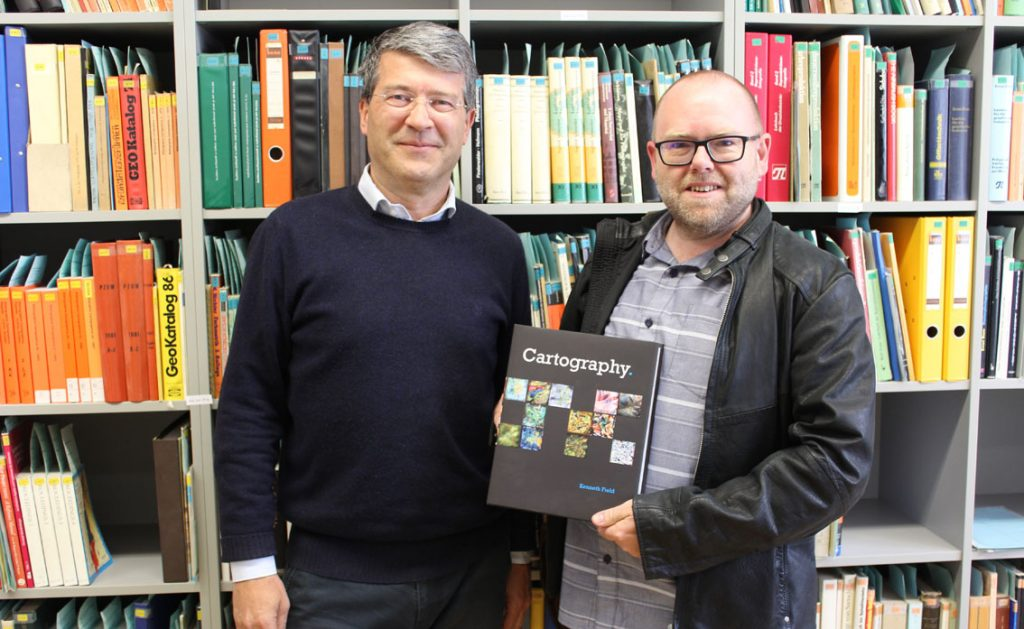 Kenneth Field handing over a copy of his book Cartography to the library of the Cartography group